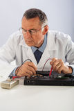 Senior Technician Repairing Laptop Stock Image