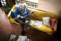 Older man. Older adult man reading newspaper, real person is not a model Royalty Free Stock Photography