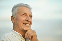 Older man on background of the sky. Portrait of an attractive older man on the background of the sky stock photos