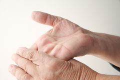 Older man bends hand back Stock Image