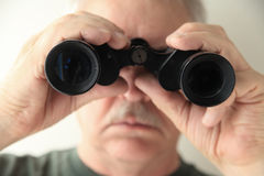 Older man with binoculars Stock Photo