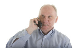 Older Man in Blue Shirt on Cell Phone Stock Image