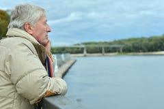 Older man on the bridge Royalty Free Stock Image