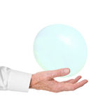 Older man in business shirt catches bubble. Royalty Free Stock Photo