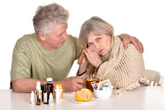 Older man caring for  sick woman. Caucasian older men caring for elderly sick woman Stock Photo
