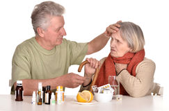 Older man caring for  sick woman Royalty Free Stock Photos