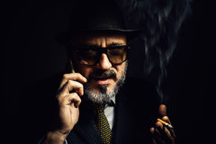 Older Man With Cellphone And Cigar Stock Photography