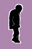 Older man in coat walking. Single older Black man walking over purple halftone background Stock Photo