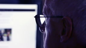 Older man at computer stock video footage