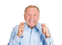 Older man crossing fingers, anticipating Stock Image