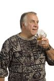 Older man drinking scotch Royalty Free Stock Photography