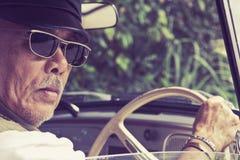 Older man driving a car Royalty Free Stock Photos