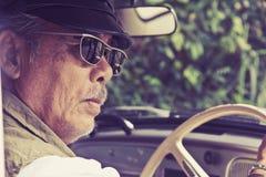 Older man driving a car Stock Photo