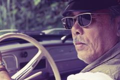 Older man driving a car Royalty Free Stock Photo