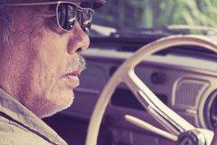 Older man driving a car Stock Photography
