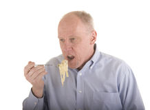 Older Man Eating Pasta Royalty Free Stock Photography