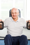 Older man exercising at the gym Royalty Free Stock Photo
