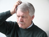 Older man is frustrated Royalty Free Stock Photos