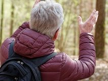 Older man gesturing with his hands royalty free stock image