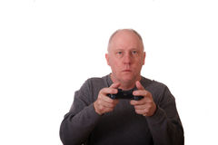 Older Man in Gray Shirt Playing Video Game Royalty Free Stock Photos