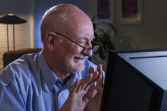 Older man grossed out with content on his computer, horizontal Stock Photography