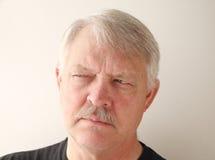 Older man has a distrusting look Royalty Free Stock Photos