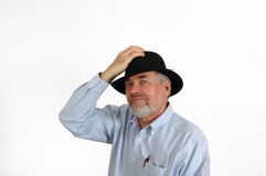 Older Man in Hat. A senior man holding his hat set against a white background Royalty Free Stock Photos