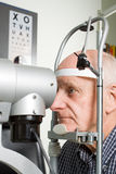 Older man having eye examination Royalty Free Stock Photography