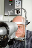 Older man having eye examination Stock Photos