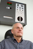 Older man having eye examination Stock Images