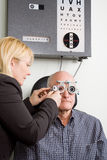 Older man having eye examination Stock Photo