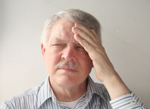 Older man with head pain Stock Images