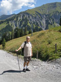 A older man Hiking. In the Alps stock image