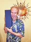 Older Man Holding Blue Box stock photo