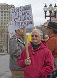 Older Man Holding Gun Control Protest Sign Royalty Free Stock Images