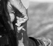 Older man holds cigarette in monochrome Royalty Free Stock Photography