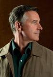 Older Man in Jacket Looking Sideways Royalty Free Stock Image