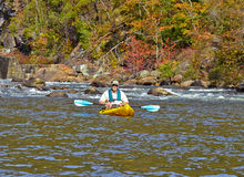 Older Man Kayaking in Autumn Royalty Free Stock Photos