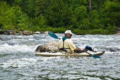 Older Man Kayaking/River Rapids Stock Photography