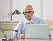 Older man on laptop. Royalty Free Stock Photography