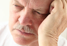 Older man looking depressed Royalty Free Stock Photos