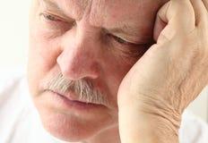 Older man looking depressed Royalty Free Stock Photos