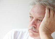 Older man looking off into space Royalty Free Stock Image