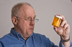 Older Man Looking at Prescription Bottle Stock Photo