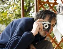 Older man making pictures Royalty Free Stock Photos