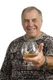 Older man offering a scotch Stock Photo