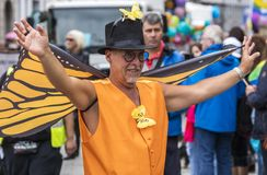 2019: An older man with orange butterfly wings attending the Gay Pride parade also known as Christopher Street Day CSD in Munich