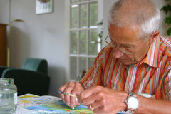 Older man painting Stock Photography
