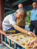 Older man playing traditional Chinese chess. In the long corridor of the Temple of Heaven, Beijing, China Stock Image