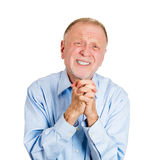 Older man pleading, begging Stock Photo